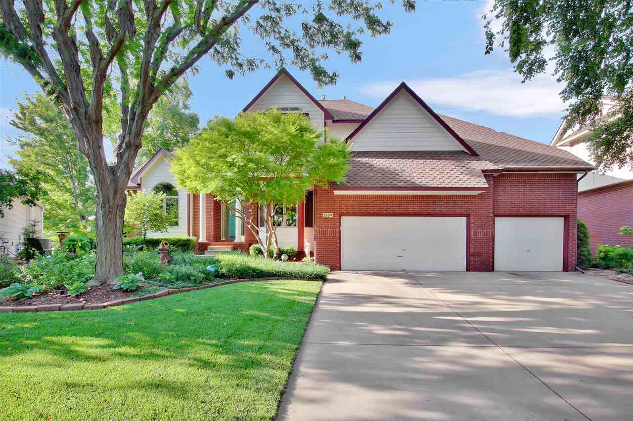 One owner, custom built, meticulously maintained, updated throughout, professionally landscaped, no backyard neighbors, cul de sac lot, golf course view, Maize South schools in the coveted West Wichita neighborhood of Reflection Ridge. Park like setting with mature trees along with a front paver patio greet you as you approach this jewel of a home. Entering you will find soaring ceilings, dramatic stairway, picturesque windows with views of your tree canopied backyard, formal dining with plenty of room for your family table and hutch, formal living, wood floors and fresh paint. The pride of ownership and grandness of the home is evident immediately. Master bedroom is on the main level and features a trey ceiling, double closets that provide abundant storage, door to deck, bay window with more views of your park like setting and room for king sized furniture. The master bath has been updated with tile shower, tile floors, new back splash and double separate vanities. Master bath also has a whirlpool tub, arched window and ledges for decorating with lighting.  Kitchen has been updated and has wood floors, gas JennAire stove top, granite counters, expansive counter space and prep space , granite eating bar and offers space for friends and family to gather. Hearth has a stunning focal with limestone stacked stone from hearth to ceiling, wood floors, built in shelving, additional views of your private backyard and creates another space for gathering or relaxing. Main floor additional features include separate laundry room with window and a half bath which have also both been updated. Wood steps on stairway lead to a loft perch area and two terrific sized bedrooms with step in closets and newer carpeting. These bedrooms have a jack and jill bath with separate granite vanities for each room along with tile floors. Again, these have both been updated. Basement has family room with gas fireplace, newer carpet, newer paint, updated tile and stone wet bar, walk out and view ou