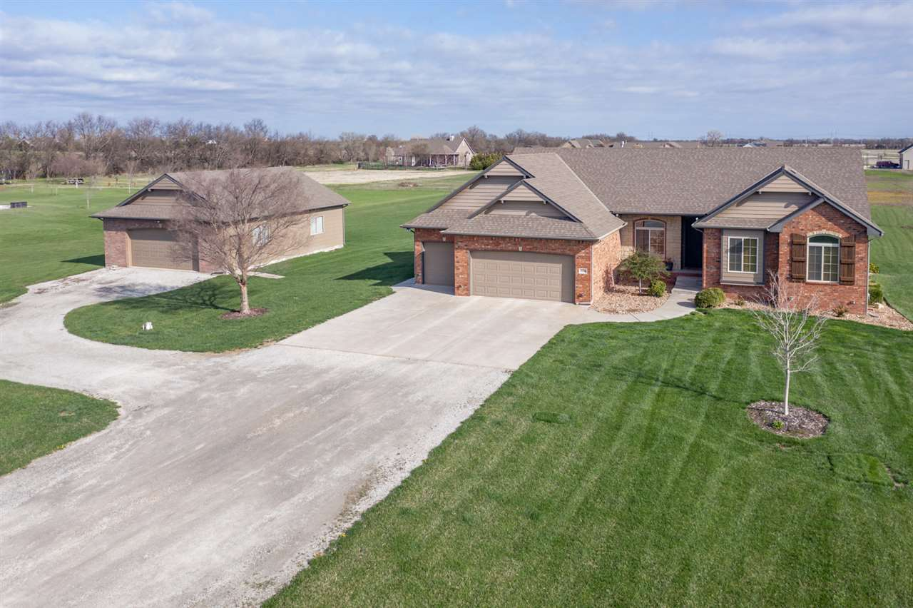 Loving the Country Life with a home that you can be so proud of!  You don't want to miss this beautiful and well maintained 2.5 acre home in Benton! One owner home.  This 5 beds and 3.5 bath home has an oversized detached garage/work space (30x40) in addition to the three car heated attached garage. As you walk in the front door you are greeted with an open floor plan and a dining area and living room combo with a cozy fireplace. The kitchen features a white quartz island and white quartz countertops plus a dining space and hearth room and beautiful hardwood floors. Formal Dining room with hardwood floors.  The beautiful main floor master has vaulted ceilings plus a walk in closet. The master bath has two separate sinks with quartz countertops, a large tub and a separate shower. Main floor laundry with wash sink on main floor and cabinets for storage. The basement has a spacious living area with its own wet bar and fireplace plus two additional bedrooms and a bathroom. Enjoy a spring evening on the covered deck and take in your view. Call today for a private showing!