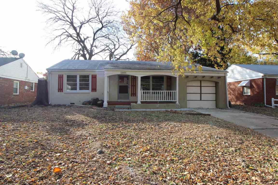 Cute ranch on quiet street with awesome wood floors, large rooms, tile floor in kitchen, cedar closets, double closets in master bedroom, newer hot water heater, new roof, updated electric, attic storage above garage, fenced backyard! Enjoy the covered front porch!
