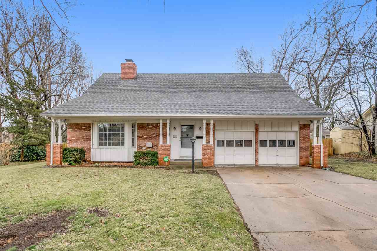 Great Family Home with inviting Front Porch.  Fenced Yard with Mature Trees and a Sprinkler System.  50 Year Impact Resistant Roof.  Windows replaced 2016.  Hot Water Tank is 1 year old.  2 Way Fireplace between Main Floor Living Room and Main Floor Family Room.  Formal Dining Room.  Sun room with Heat/AC.  Remodeled Bathrooms.