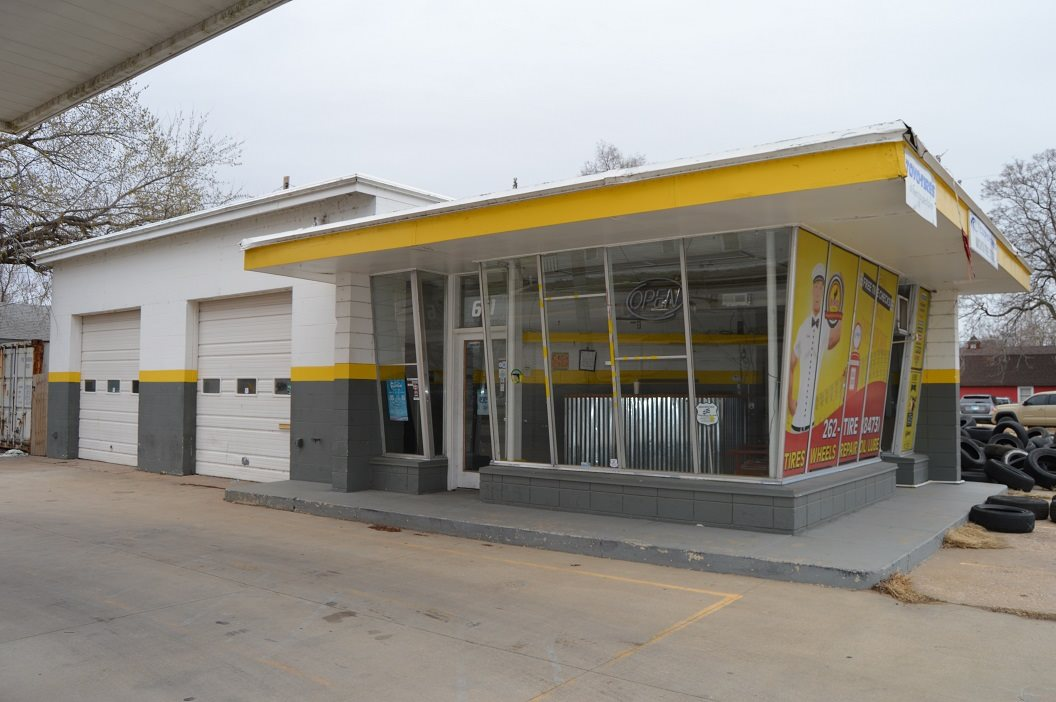 Former neighborhood gas station with two service bays, property could be utilized for several different uses.  Offered For Sale or Lease.  Lease rate is $1300 per month, modified gross.  See agent for additional details.