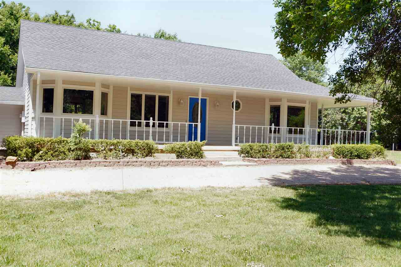 Location, location, location! If you are looking for a well built, ranch home on a paved road in God