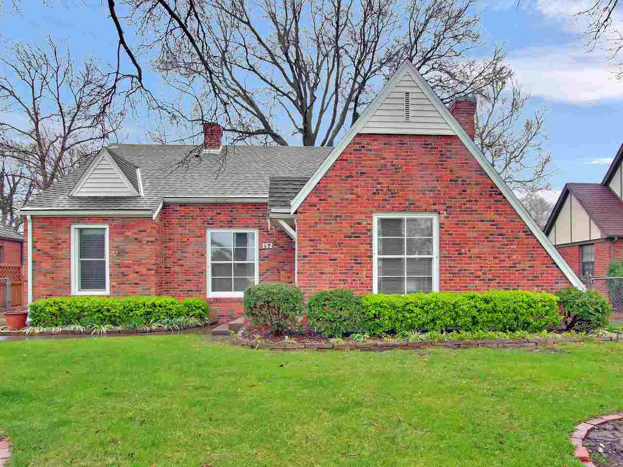 This home is a charmer…from the tall oak trees to the brick exterior to the newly refinished hardwood floors.  Walk into the spacious living room and notice the big windows, beautiful woodwork and decorative fireplace.  Host your friends and family at your big table in the formal dining room.  The hardwood floors continue into the dining room and down the hall to the master bedroom.  There are two more bedrooms and one bathroom on the main floor.  The kitchen has been updated with white cabinetry and newer appliances.  There is additional space in the kitchen for another table.  The entertaining space continues into the backyard with a brick patio underneath one of the larger oak trees in Wichita.  The basement has one finished room with a cedar closet and a large laundry room with large built in shelves for storage.  This home has been well maintained and there are many updates including: newly refinished hardwood floors and interior paint in 2020;  new sewer line with backflow preventer in 2017; new garage door in 2015; new sprinkler system panel in 2014; new Trane HVAC in 2010, new garage door opener in 2009, new Gutter Helmet in 2007; and new roof in 2006.  Bring your family and make this your home!