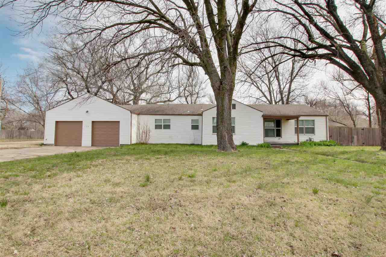 Nice large ranch home!  This sprawling ranch home has all the room you are looking for inside and out!  Home is a 4BR 2BA with a living room and family room.  Large open kitchen and main floor separate laundry room.  Home sits on a large corner lot that is just over 1/2 an acre in size!  Large Detached garage with a 2 car overhead door for a shop or do it yourself mechanic.  Schedule a showing today!!!  Property will be sold as is..no repairs