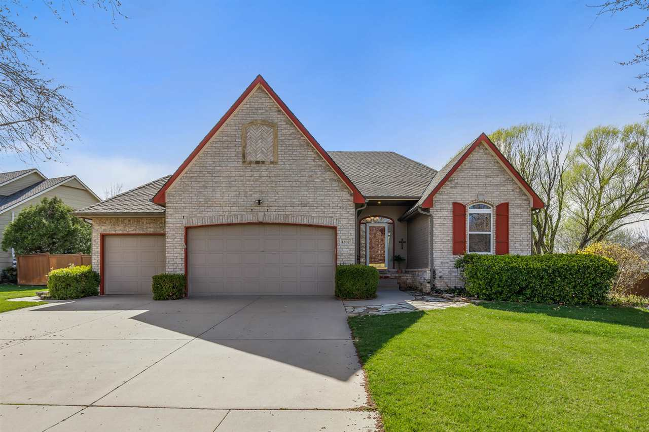 SITTING IN ONE OF WICHITA'S MOST DESIRABLE NEIGHBORHOODS THIS HICKORY CREEK RANCH OFFERS TONS OF NAT