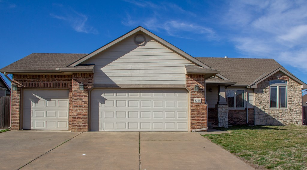 A great ranch style home with a large basement, backyard and covered deck to entertain your family a