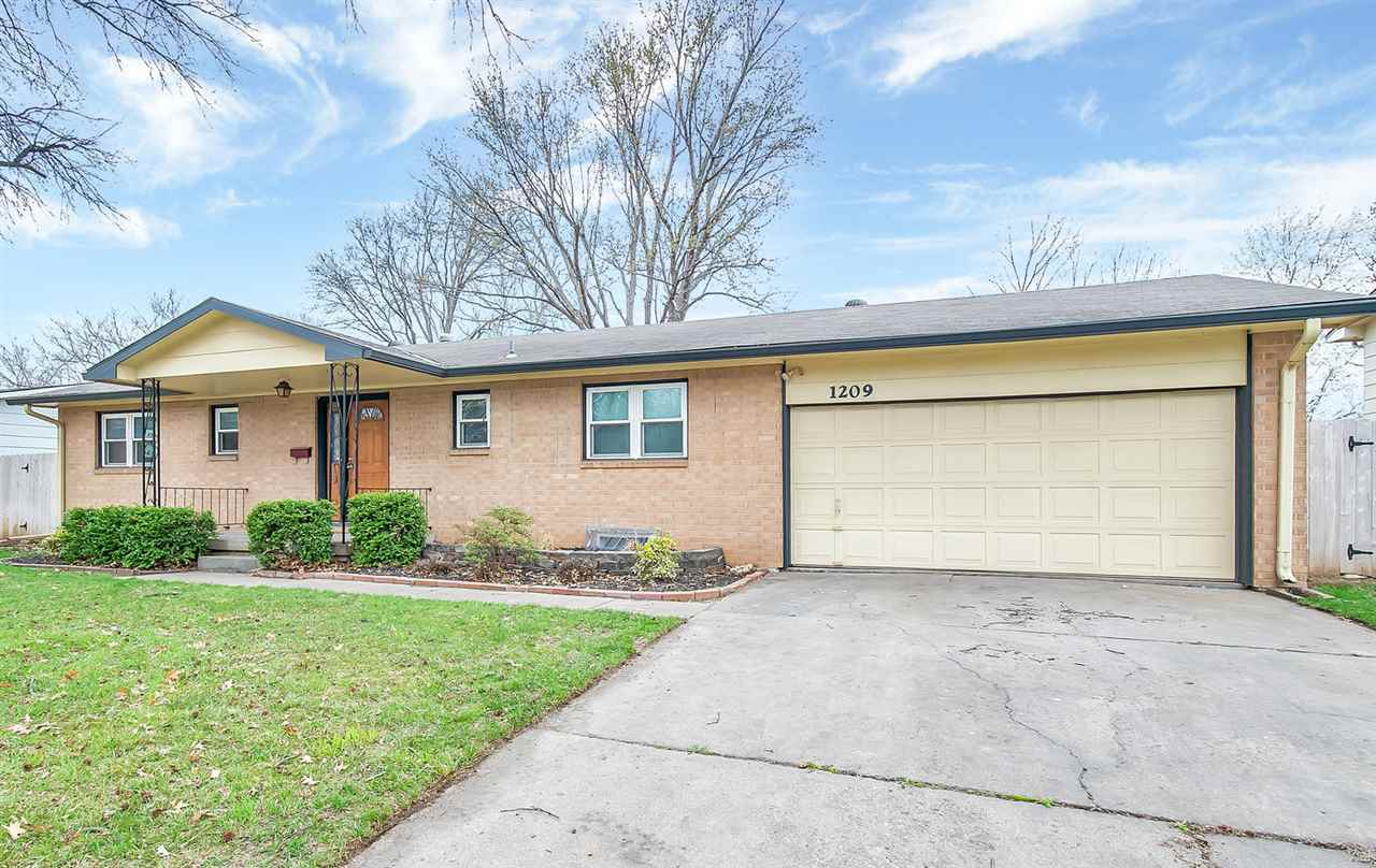 You won't want to miss out on this move-in ready home in Country Acres!  As soon as you walk in you