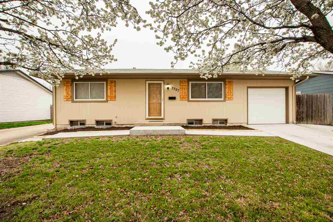 Welcome Home!! This gorgeous home will wow you right when you drive up with the new exterior paint a