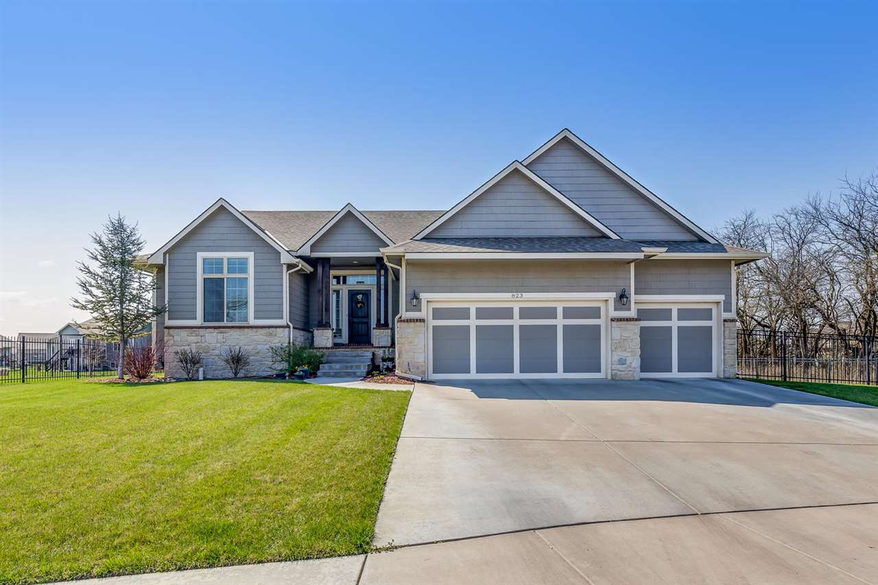 Stunning & spacious home on an almost 1/2 acre lot in the coveted Cornerstone! This 5 bedroom home i