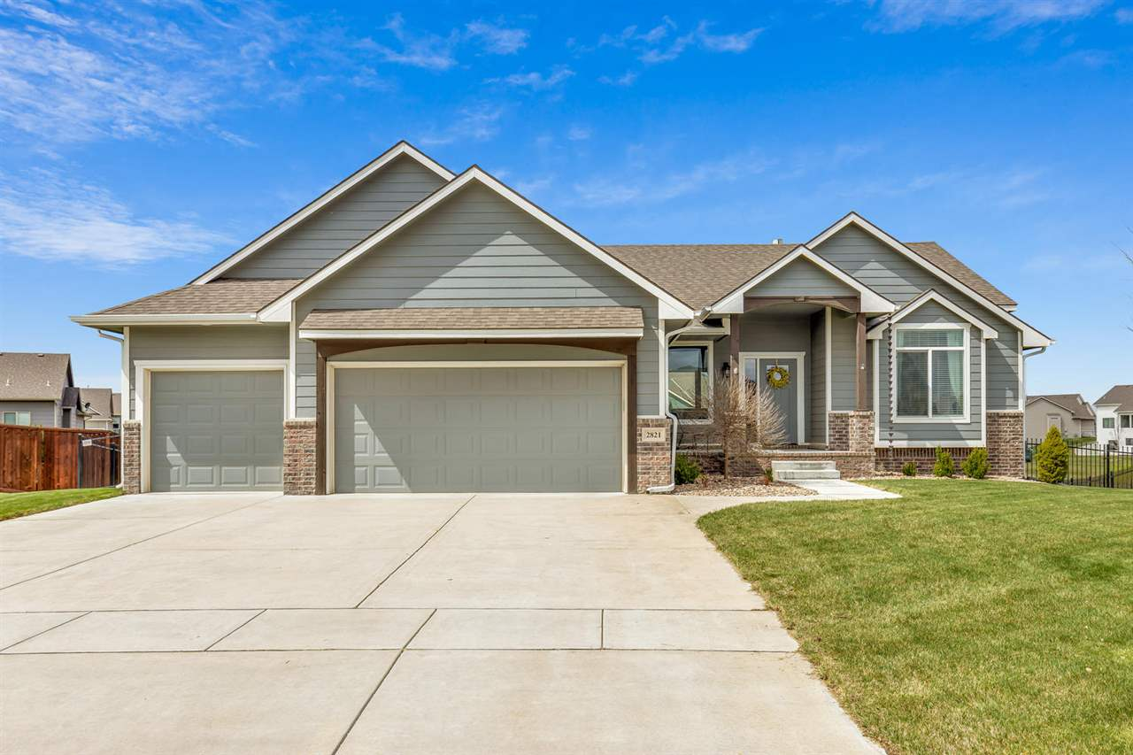 Check out this beautiful NE Wichita ranch home in the highly sought after Firethorne neighborhood. T