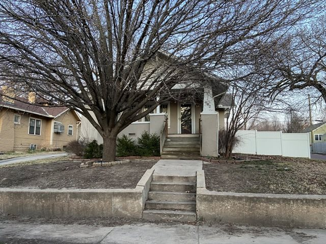 This 2 bed 1 bath bungalow offers over 1100 sqft, corner lot, covered porch, 2 car detached garage,
