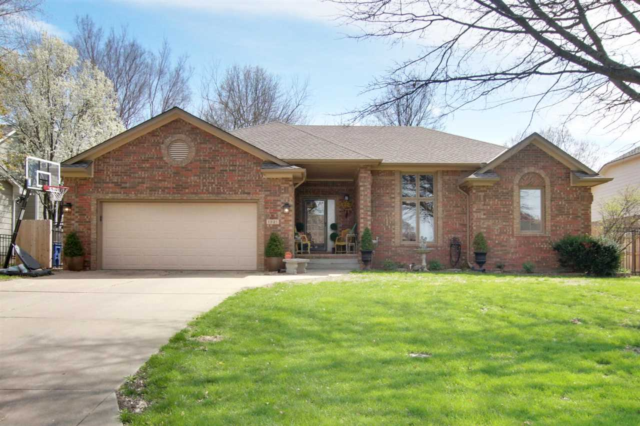 Located in desirable Oakwood Valley Addition in Derby, this 4 bedroom, 3 bath Ranch is a Standrich b