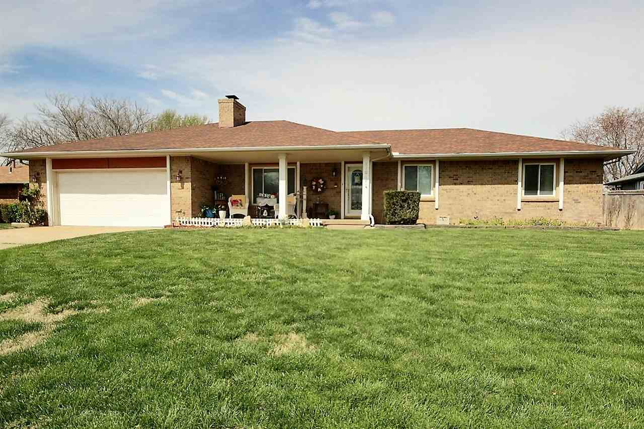 This 3 bedroom, 3 bath, 3 car garage full brick home in Maize schools welcomes you in right from the