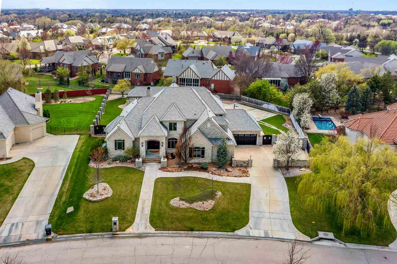 Truly a stunning estate located in the gated community of The Keeneland at Wilson Estates.   Upon en