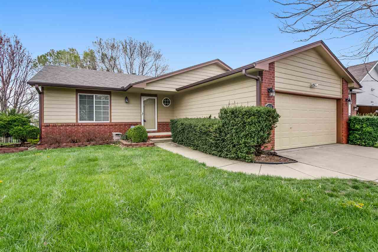 Wonderful one story in Whispering Brooks. Located near highways and the best of East Wichita, you wo