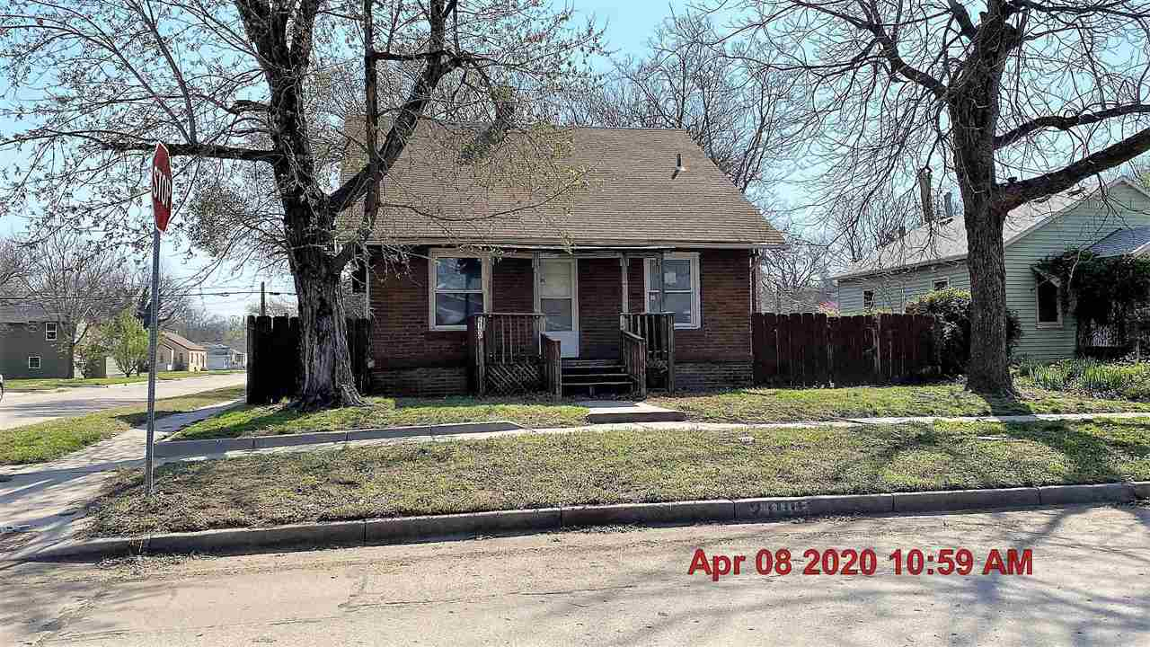 On corner lot is this 3 bdrm, brick home with partial basement and two car det garage.
