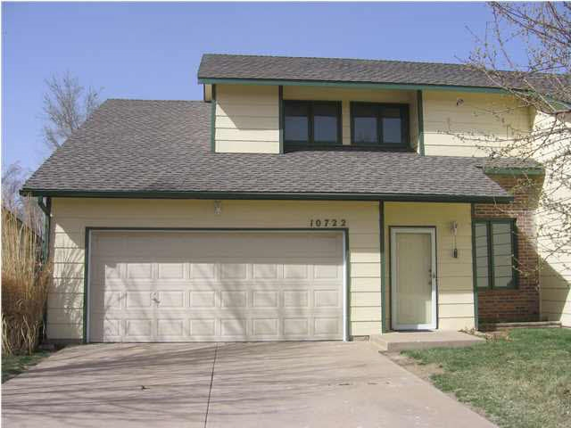 Take a look at this spacious twin home.  3 bedroom, 1.5 baths, fully fenced back yard and 2 car garage. There's three different family areas, a hearth room off the kitchen, a formal living room as you enter the front door and another family room downstairs!  The big things have been done, the Air Conditioning is just 6 months old and the roof is just 1 month old, that will help big time on insurance costs.  This is pretty maintenance free living!  Located close to shopping, entertainment, churches, close to Kellogg and all you could want but out of the traffic pattern.  This is a perfect place for someone starting out or someone downsizing, a single or small family.  Come see what could be YOUR new home!!