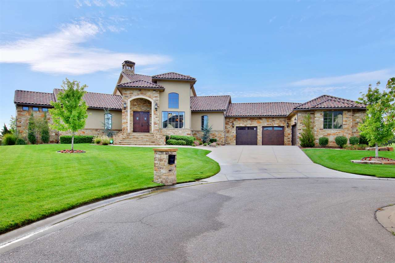 Remarkable Custom Built Stucco Estate home nestled on a half acre private lot in Fox Ridge Estates.