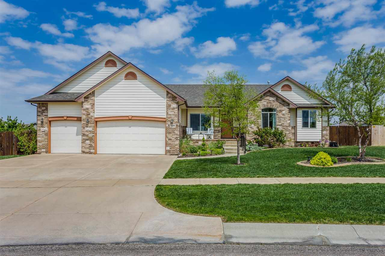 Wow!  This One Owner, Custom Built Ranch is Going to Knock your socks off!  Nearly 1800 Square feet on the Main Level plus a Full Finished Basement!  5 Bedrooms, 3 Bathrooms, All Seasons Room and a 3 Car Garage!  Upon Entering the Foyer you will notice the Formal Living Room with Grand Barrel Lighting.   Engineered Hardwood Floors.  Gourmet Kitchen with Granite Island and Walk in Pantry.  Separate Main Floor Laundry.  3 Car Garage is over sized and 3 feet wider then standard and Taller Ceilings.  Formal Living Room with a Fireplace.  Master bedroom has a private entrance to the outdoor oasis!  6 foot Privacy Fence with Steel Posts.  Lush, huge Yard with a Sprinkler System.  In Ground Salt Water Pool with a new liner and auto cover.  Plenty of Patio and Privacy AND an Entertaining All Season Room with built in cabinets.  Full Finished Basement with Family Room and a Wet Bar, 2 more Bedrooms and a Full Bathroom and Plenty of Storage.