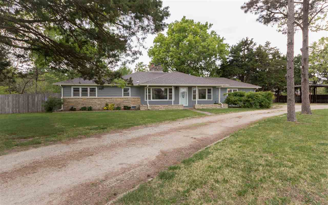 Stunning 3 bed - 2 bath - ranch with an attached garage situated on a beautiful 1 acre corner lot in