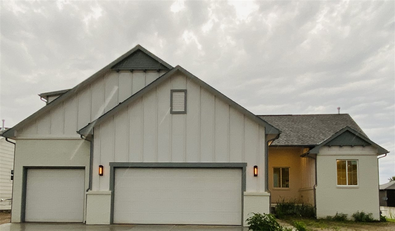 This stunning modern craftsman style home has a modern, open floor plan with vaulted ceilings and be