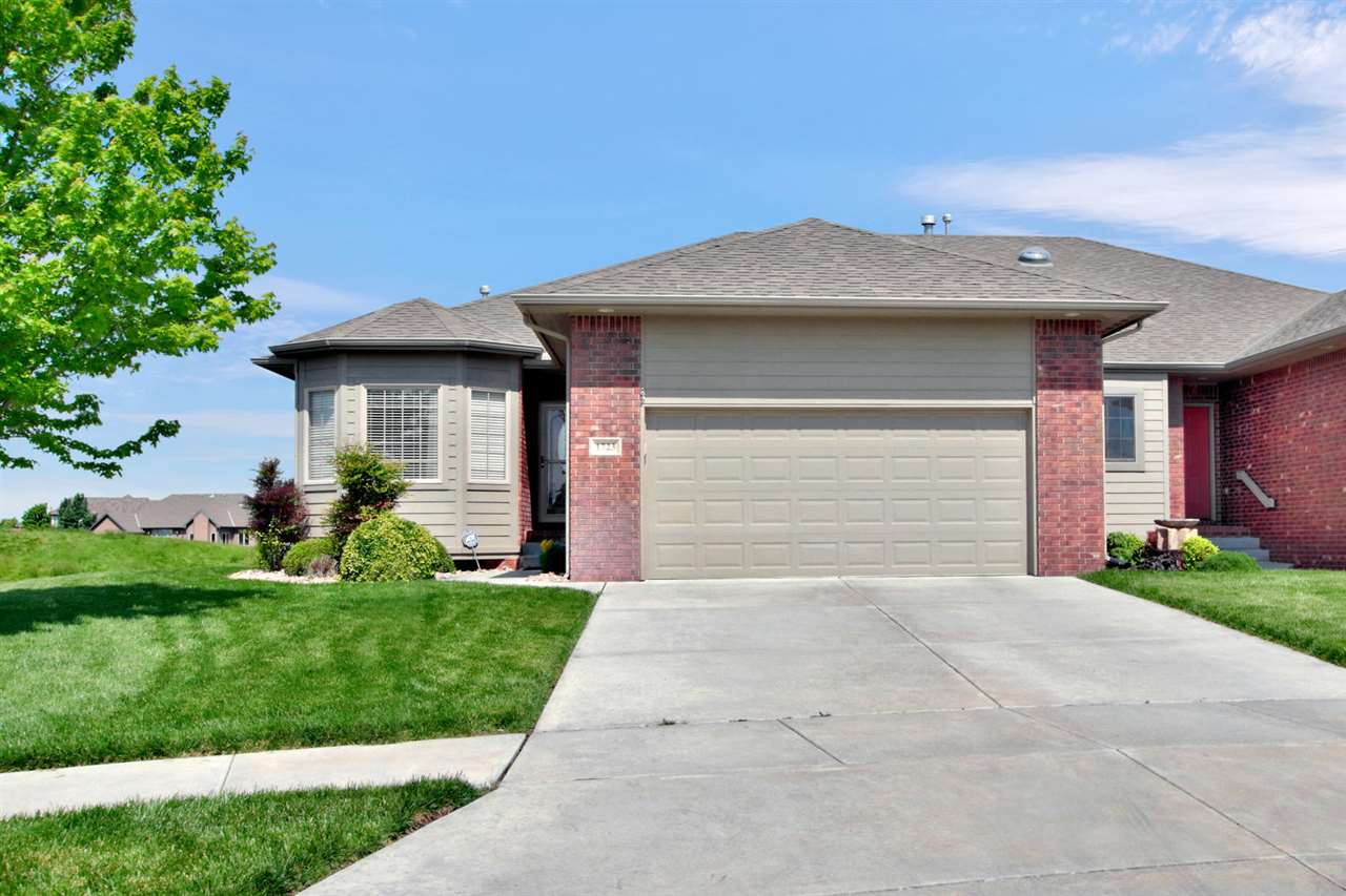 Beautiful custom twin home with fairway views of Sand Creek Station Golf Course! The seller spared no expense or detail. Boasting over 1500 square feet on the main floor, the layout is perfect! Cove molding detail throughout. Open kitchen and dining areas. The kitchen is a dream with top of the line appliances, hardwood flooring, granite counter tops, large walk in pantry, eating bar, gas cooking, accent lighting and more! Open to the living room with built in media center and hardwood flooring. Main floor utility room. Screened porch with french doors off of dining area, enters to an over sized deck area. Built in storage area under deck. Master suite includes coffered ceiling detail, windows with fairway view, bath with double vanity, over sized walk in shower and seasonal walk in closet. The lawn is complete w/ well and sprinkler system. A 50 year roof too! Two additional bedrooms and bath in basement. Rec room is stunning with beautiful trim detail, gorgeous wet bar, and gaming area. Lift chair included from main floor to basement. Storage room with built in shelving. Top of the line heating and air units. Very low utilities. Special taxes are low as they are shared between units. This is a great way to keep your square footage, but easing the burden of a large yard! HOA includes community swimming pool.