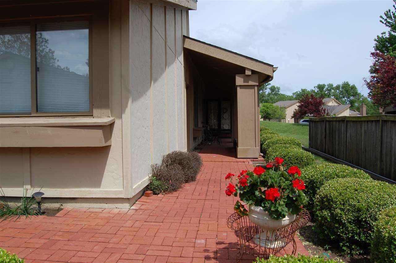 Beautiful Condo in Cedar Lakes Village. 3 Bedrooms, 2 Baths, 2-Car Garage. PRIDE OF OWNERSHIP! This Condo has been completely updated with granite counter tops, new flooring through out, new appliances, including washer/dryer(all negotiable). New interior paint, new guttering, new garbage disposal. Privacy fenced back yard with beautiful lawn, perfect for your pets. New sliding glass door leading out to back yard. Heating and Air Conditioner new in 2018. Roof new 2018. Beautiful wood laminate flooring in kitchen, living, dining and hallway. Carpet in bedrooms. Seller's have really cared for this home/Condo, and it shows!!! You won't want to miss seeing this! These Condo's comes complete with a large Clubhouse, perfect for parties and family gatherings for any occasion, also indoor pool, outdoor pool, & weight room. Call TODAY for your private showing.