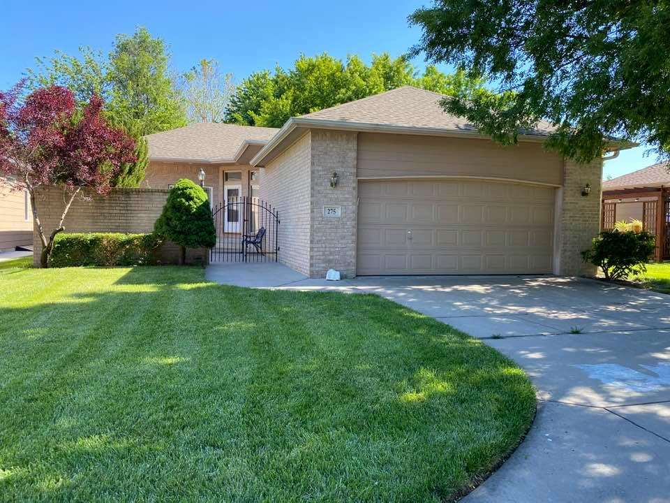 Maintenance free living! This spacious west Wichita patio home is close to amenities including Rolli