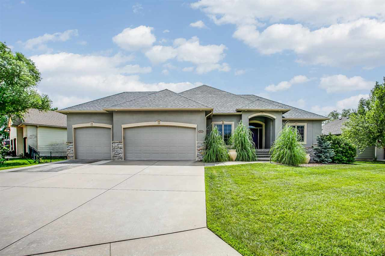 Must see this stunning Parade of Homes winner located in desirable Tiara Pines Addition.  The beauti
