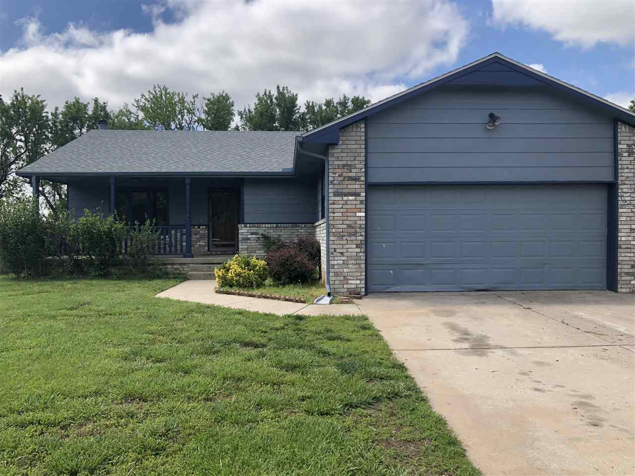 This 4 bedroom 3 full bath home in the Goddard school dist has new roof, new siding, new luxury vinyl flooring thru out most of the house.