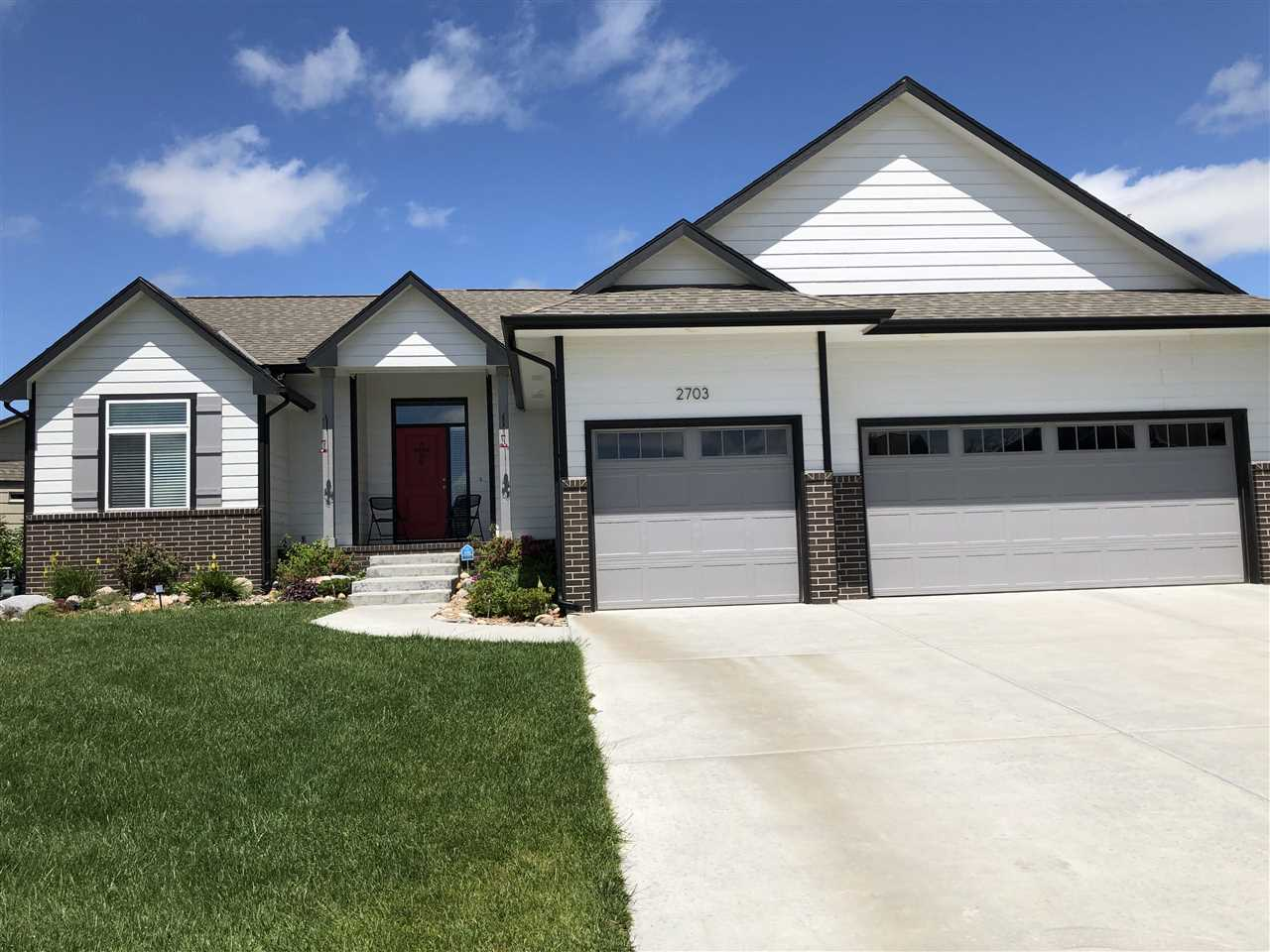 Beautiful 3 bedroom, 3 full bath home in Copper Crest Addition. This better than new home features a