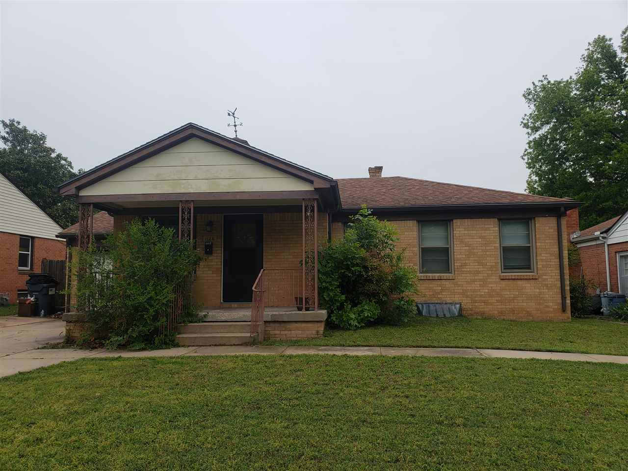 Super cute and incredibly well cared for 3 bedroom, full brick home with fenced yard, covered front