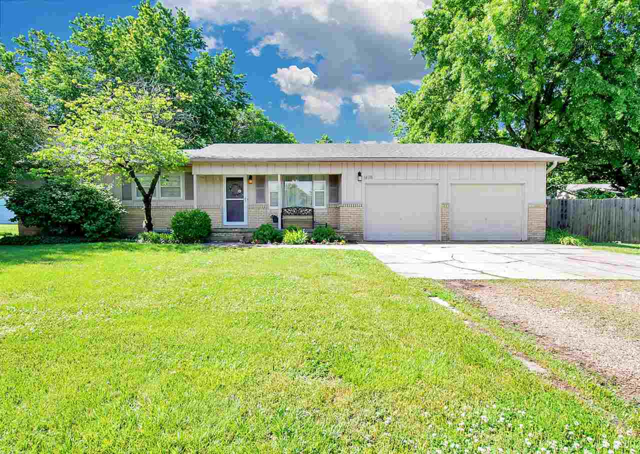 This is a nice sprawling Ranch in West Wichita nestled on a half Acre lot. There are 4 bedrooms on t