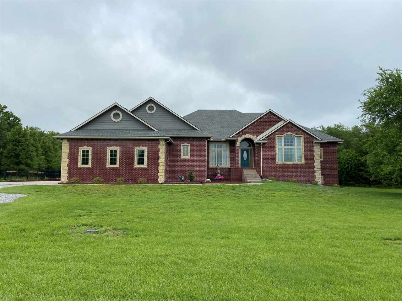 Located in the ever popular Hidden Estates community, this 4800 sq/ft home sits on 5 acres with a po