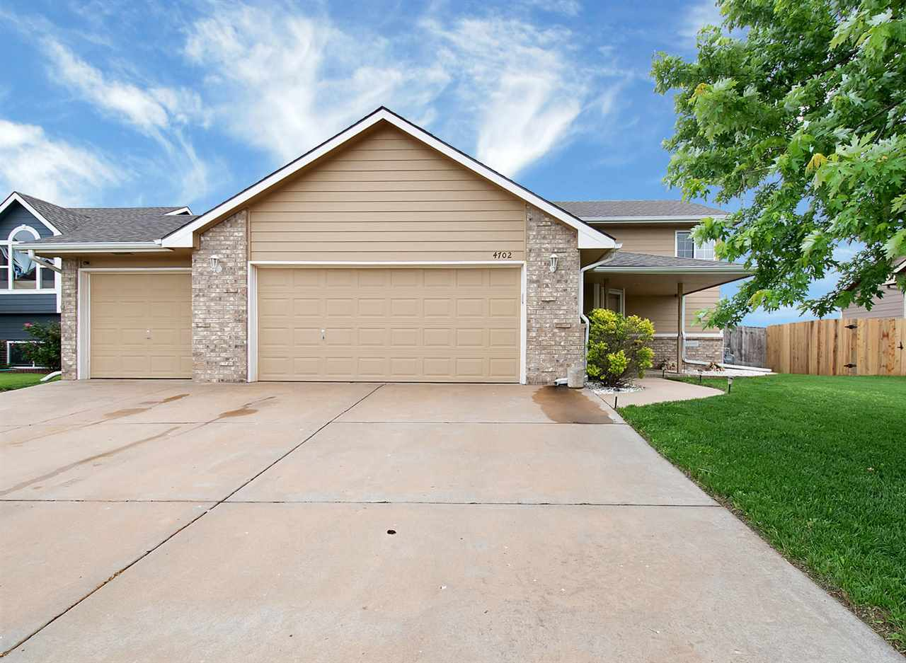 Spacious 4 bedroom 3 bath 3 car garage bi-level home with no rear neighbors. The master suite has a