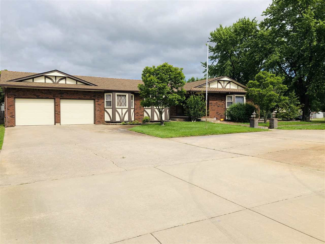LOOK AT THIS SHOP!  This gorgeous 3/4 brick Ranch home located on over 1/2 and acre boasts 4 HUGE be