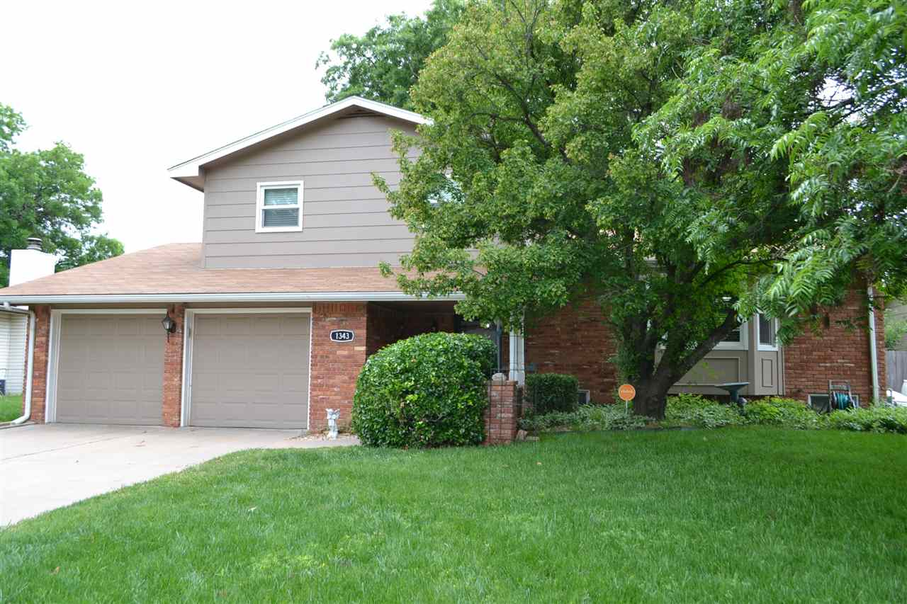 This Classic Kansas City Split level home is in super condition and has many updates! Large covered