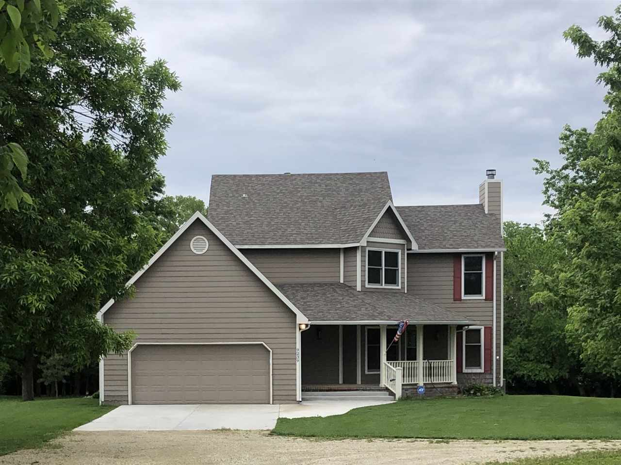 Peaceful country living awaiting you!  This stately homes sits a 6.83 acre private oasis with trees,