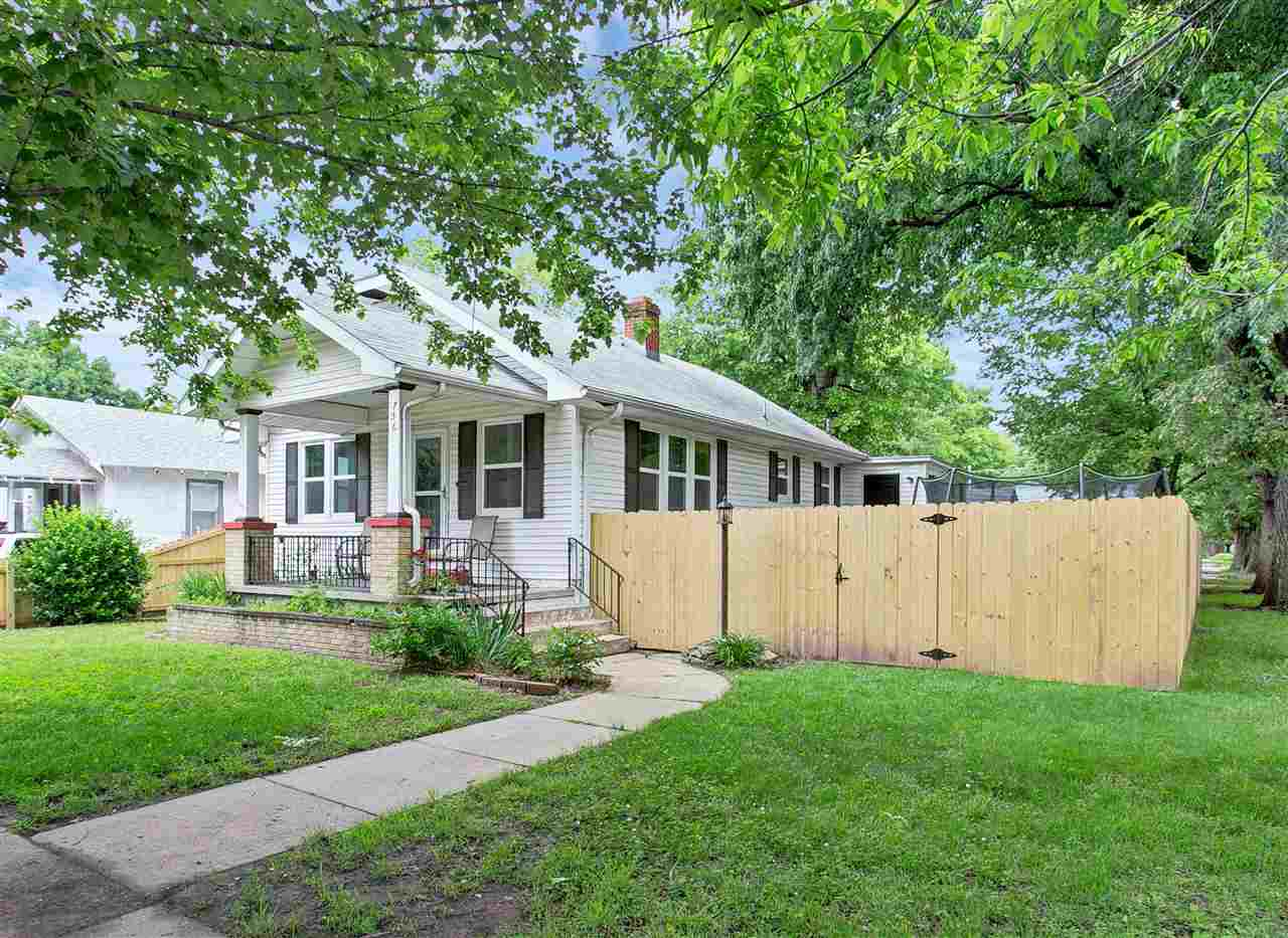 This adorable home has so many details:  new windows, front covered porch, new fencing, remodeled ba