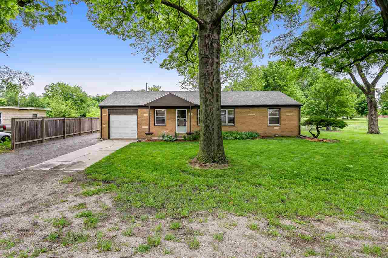 Updated and move in ready! This ALL BRICK ranch is a 3 bedroom, 1 bath, 1 car garage home situated o