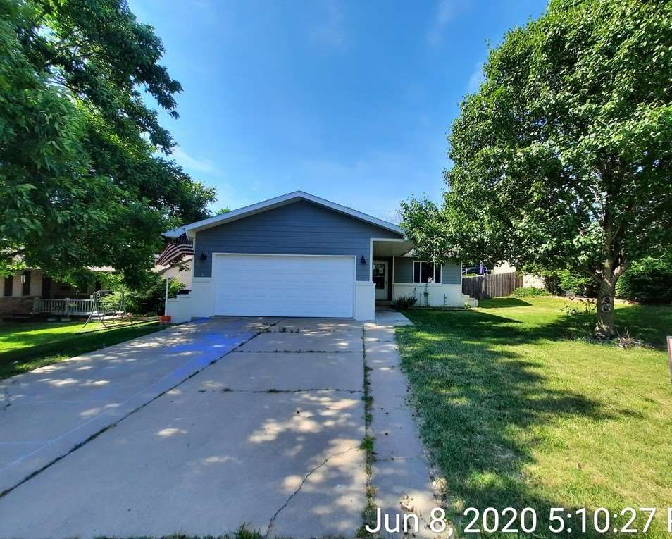 This three bedroom, 2.5 bath home features wood laminate floors, a large kitchen with dining area, a