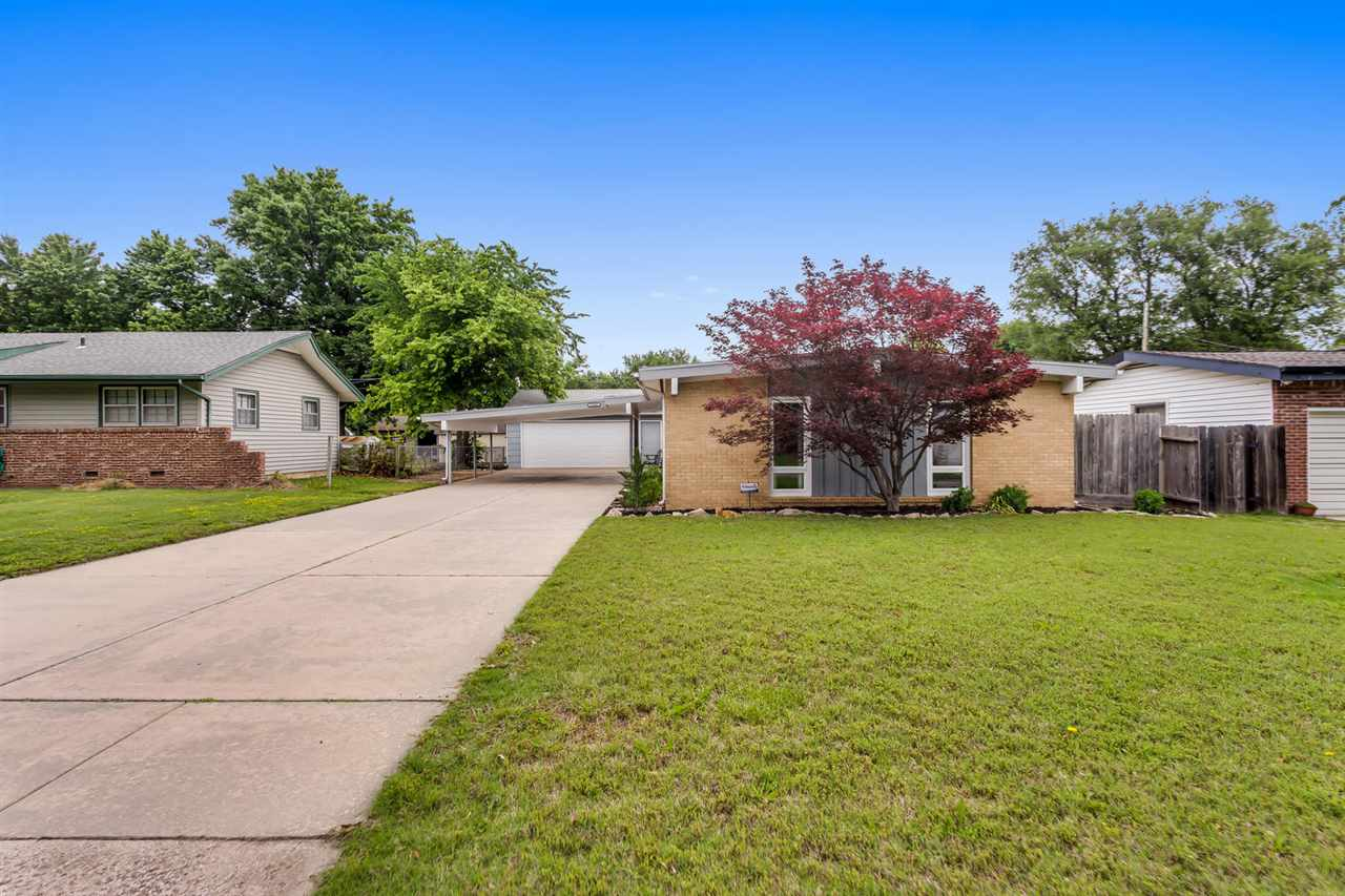 Beautifully Maintained and Move In Ready!  Home has New Carpet and is freshly painted.  Kitchen has all appliances which will stay with home.  3 bedroom, 1.5 bathrooms, Fenced yard and am over sized 2 car garage.  Washer and Dryer Stay.
