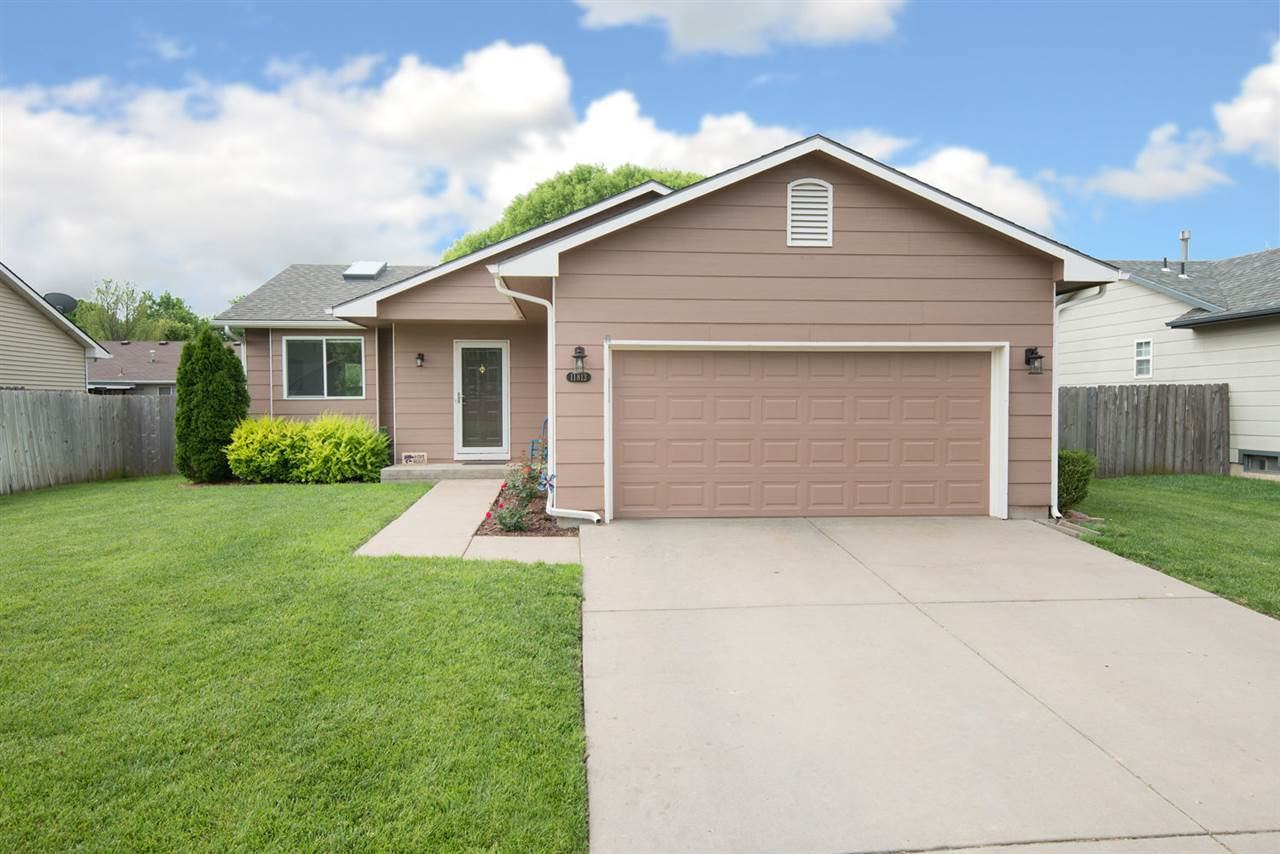 UPDATED 5 BEDROOM RANCH HOME IN MAIZE SCHOOLS!  WALK INTO A LARGE LIVING AREA WITH VAULTED CEILINGS,