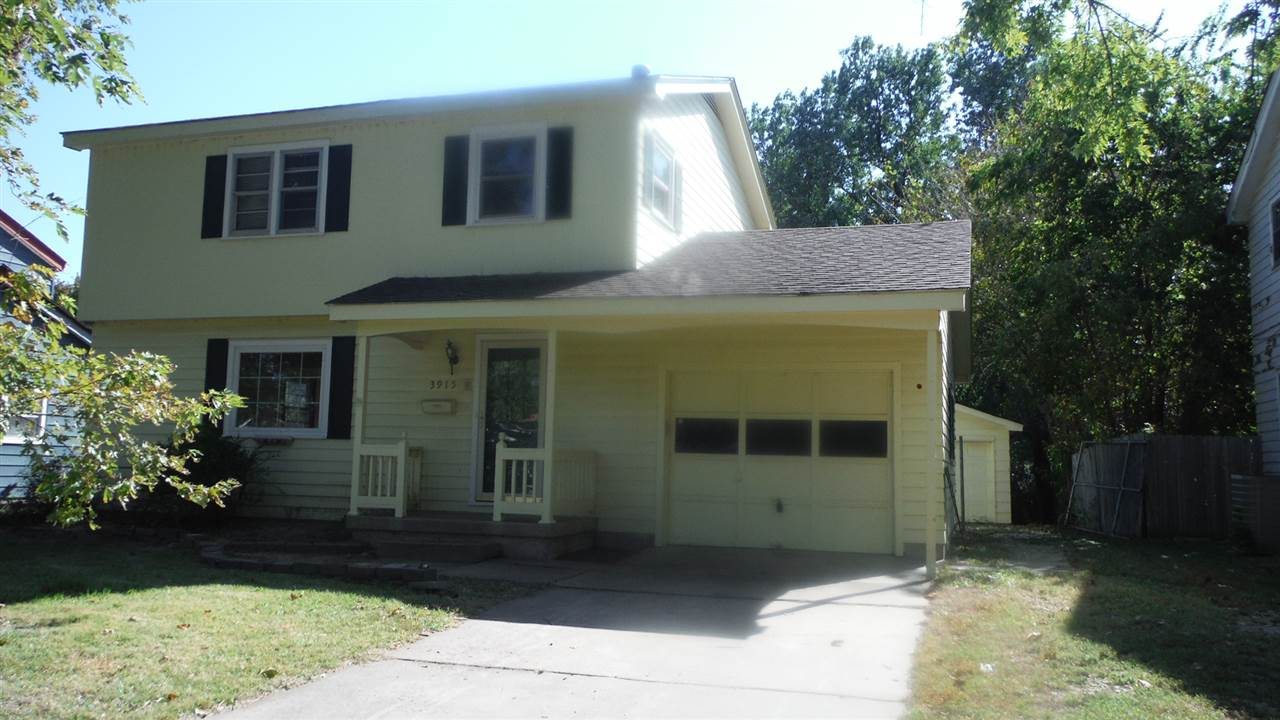What a GREAT West Side Home !!   2 Story with HUGE 4 Car - Heated detached Garage PLUS One Car attac