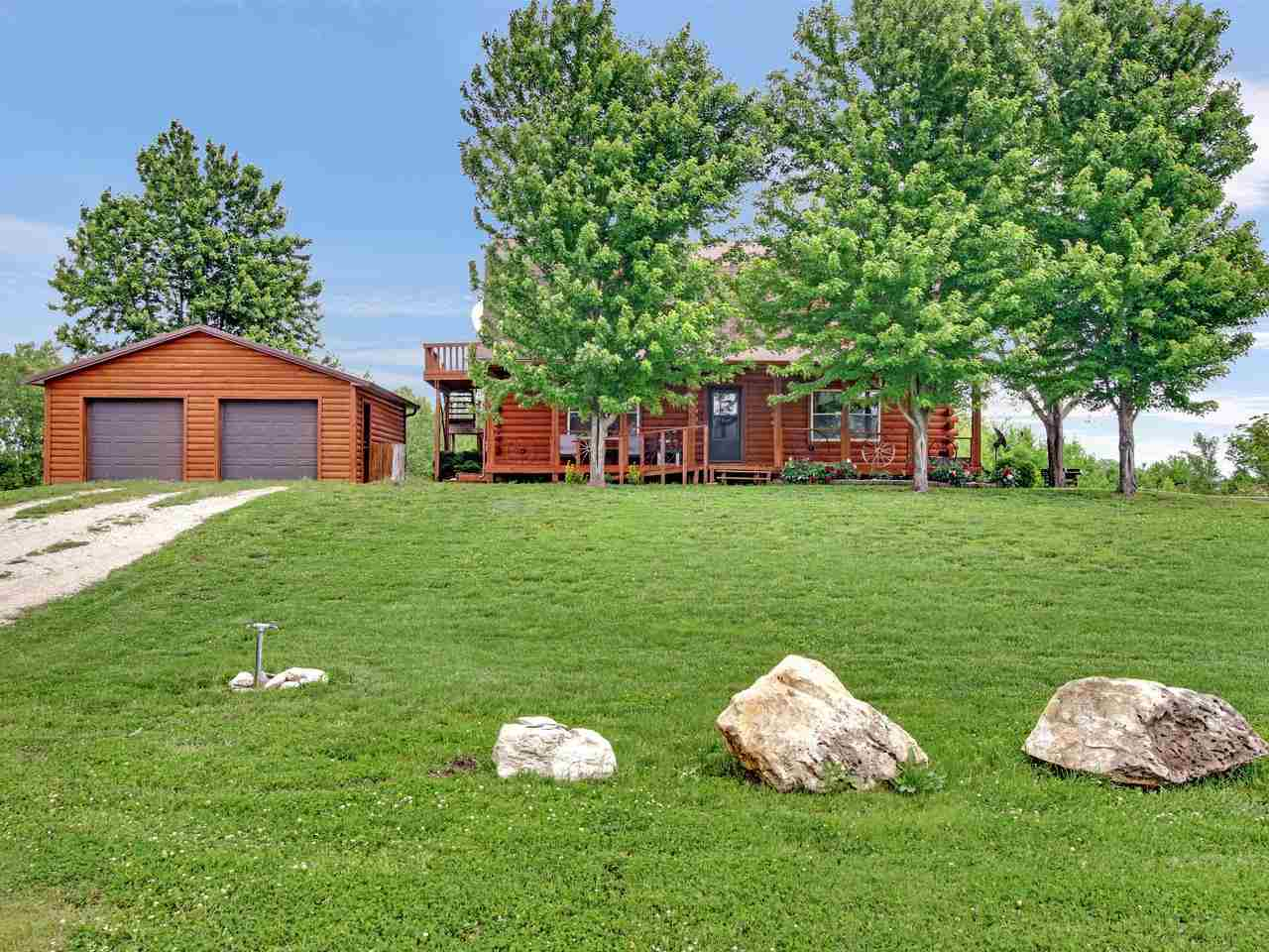 You found it! This highly sought after country living property boasts a Log Home with plenty of acer