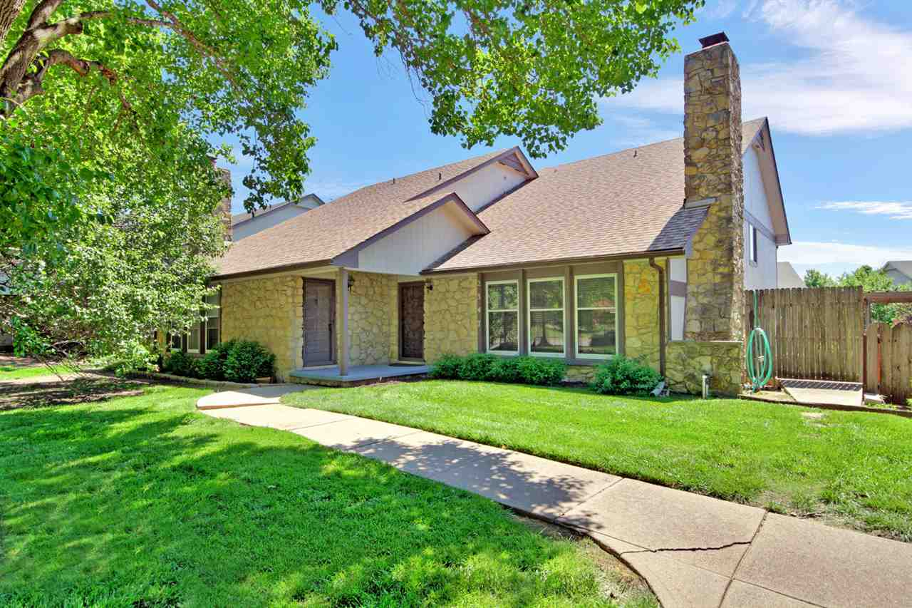 Light and bright, delightful twin home in NE Wichita.  Very well maintained home with ample room for