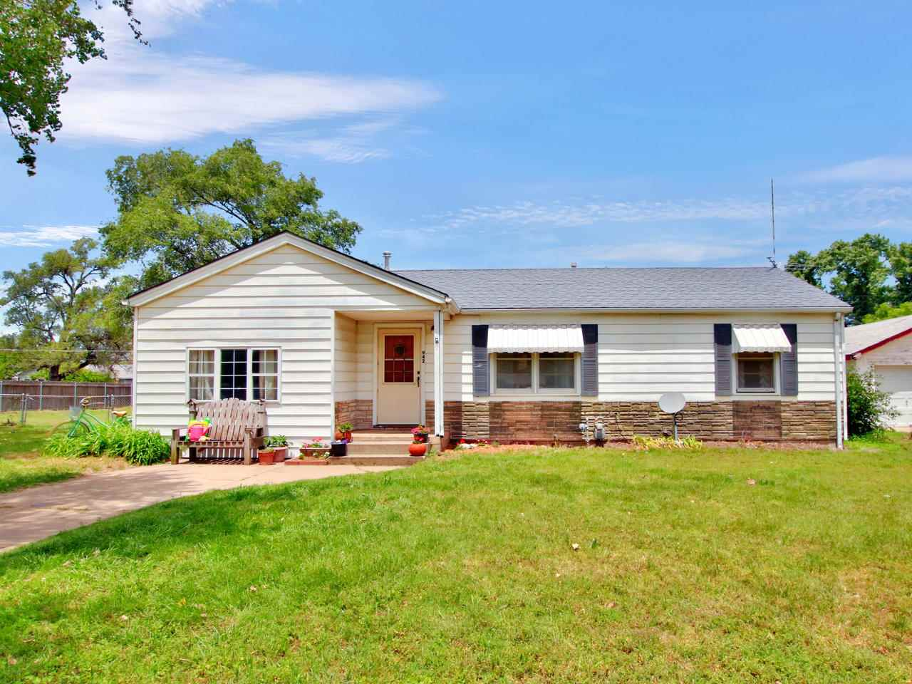 Have you been searching for a DaRLiNG home that is reasonably priced?  This cute ranch features a sp