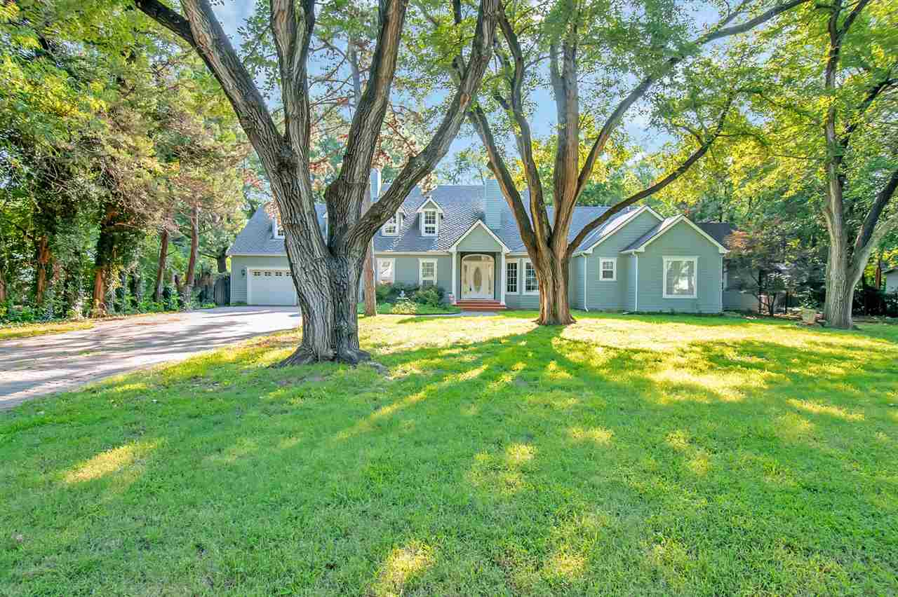 Outstanding,  One-Of-A-Kind Home on 1.25 Acres in the Heart of the West Side... Desirable Rolling Hi