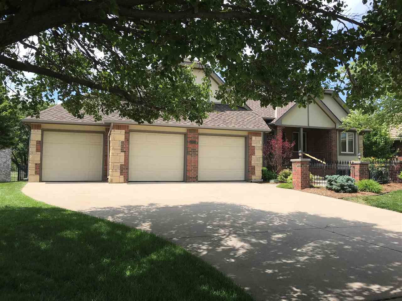 Impressive curb appeal on this brick & stone ranch in Willowbend golf community! Large living room w