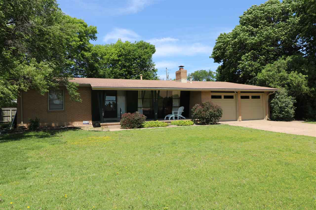 Sharp Mid Century brick ranch on a large lot. Hardwood floors throughout, formal dining room, fabulo